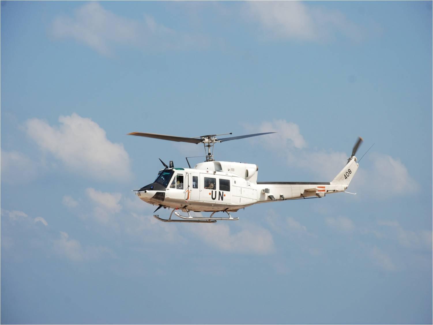 Un Elicottero : Elicottero di u citalairu d ricerca un disperso in mare u associazione